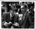 Joe Sawyer and Edmond O'Brien in a scene from A DOUBLE LIFE, 1947