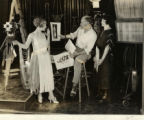 Pauline Garon, Cecil B. DeMille, and Clare West during production of ADAM'S RIB, 1923