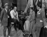 Theodore Kosloff, Cecil B. DeMille, Jeanie MacPherson, and Paul Iribe during production of ADAM'S RIB, 1923